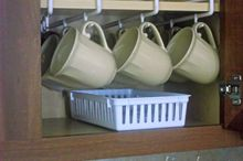 my top tips plus 12 ideas for organizing your kitchen, organizing, Using a mug rack frees up space An inexpensive basket holds lids and straws