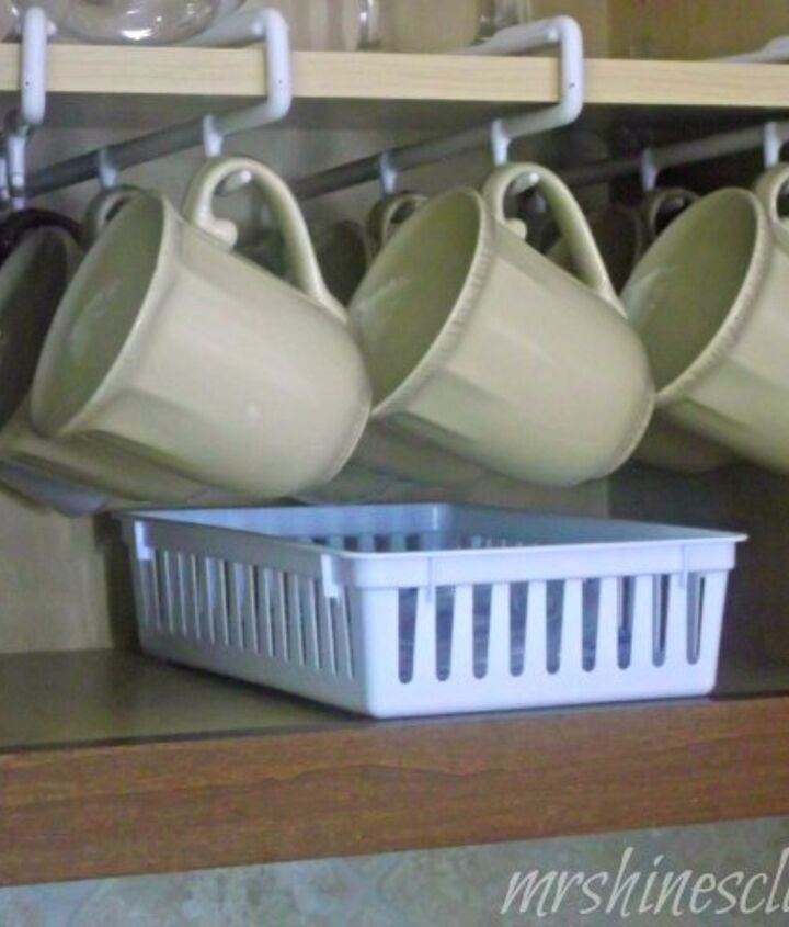 Using a mug rack frees up space.  An inexpensive basket holds lids and straws.