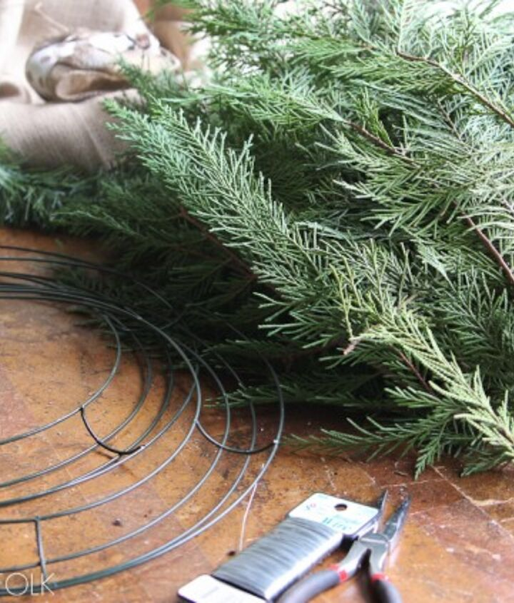 Here is what I used to make an easy evergreen wreath: 26 gauge floral wire Pliers for cutting wire Wire wreath form (found at an arts and crafts store such as Hobby Lobby) Evergreen clippings ( I used Leland Cypress) Length of fake gar