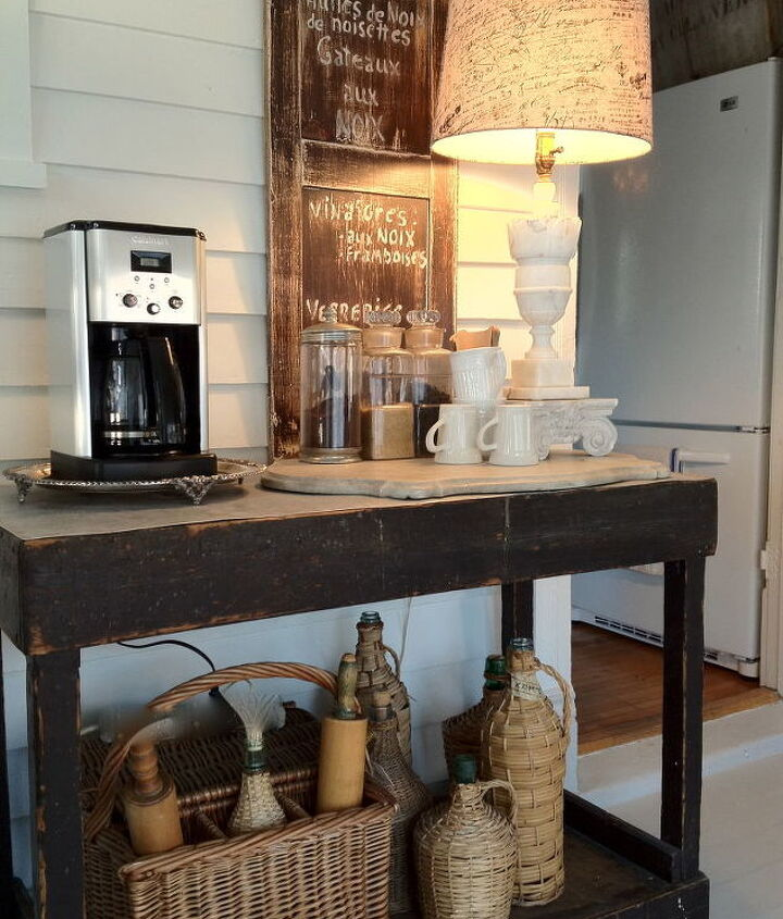 coffee station housed on galvanized covered island cups and condiments on vintage marble slab