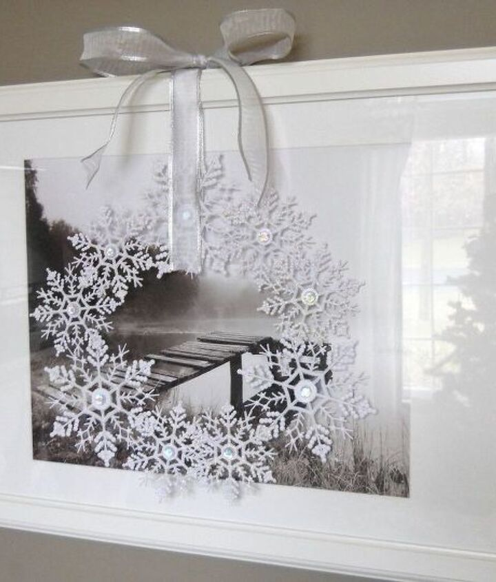 Hang in front of a window or another picture using a long ribbon.
