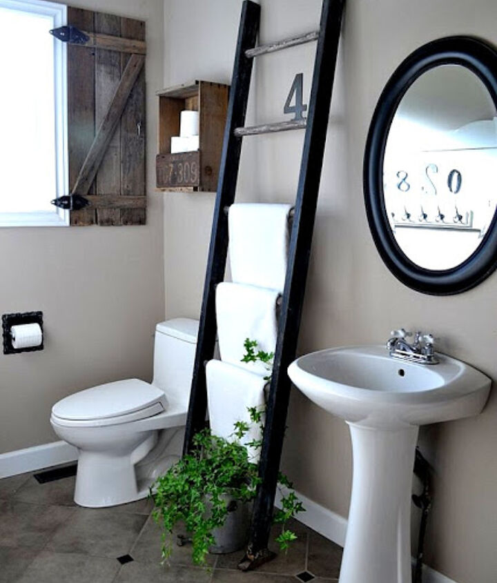Even a small bathroom stands half a chance if you choose your stuff wisely. A ladder for towel storage truly rocks as it takes so little real estate.