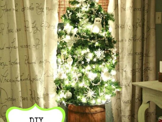 lighted tomato cage christmas tree makes it s appearance for the 3rd year, christmas decorations, crafts, seasonal holiday decor, Tomato cage faux pine garland with lights An old barrel makes for a great tree base