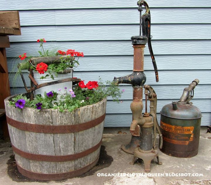 In Outdoor This and That:  Vintage Pumps, I display more garden junk with my flowers. http://organizedclutterqueen.blogspot.com/2012/06/vintage-pumps-more-futon-parts-outdoor.html