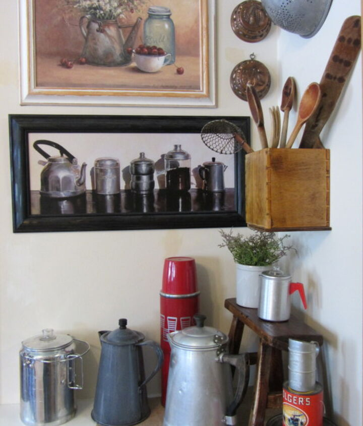 Vintage coffeepots, utensils, coffee can, scoop and Folger's puzzle.  Also a red thermos.