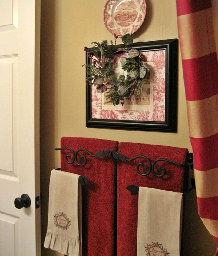 my french country guest bath, bathroom ideas, home decor, Another French print with a toile mat a plate and a Christmas wreath top one of my favorites a thrift store towel bar from the now defunct Southern Living at Home