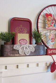 valentine s day mantel, christmas decorations, seasonal holiday d cor, valentines day ideas, Other items in the vignette include oil lamps a lantern doilies faux greenery a head vase a love sign a heart garland a sewing machine drawer a red tray a book and a felt red rose