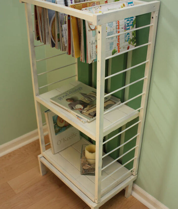 After photo of crib upcycled into a storage unit with magazine hanging rack