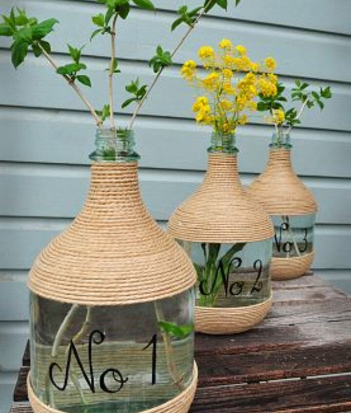Wrapped in jute and numbered:   http://www.hometalk.com/177422/wine-jugs-and-jute/photo/68108