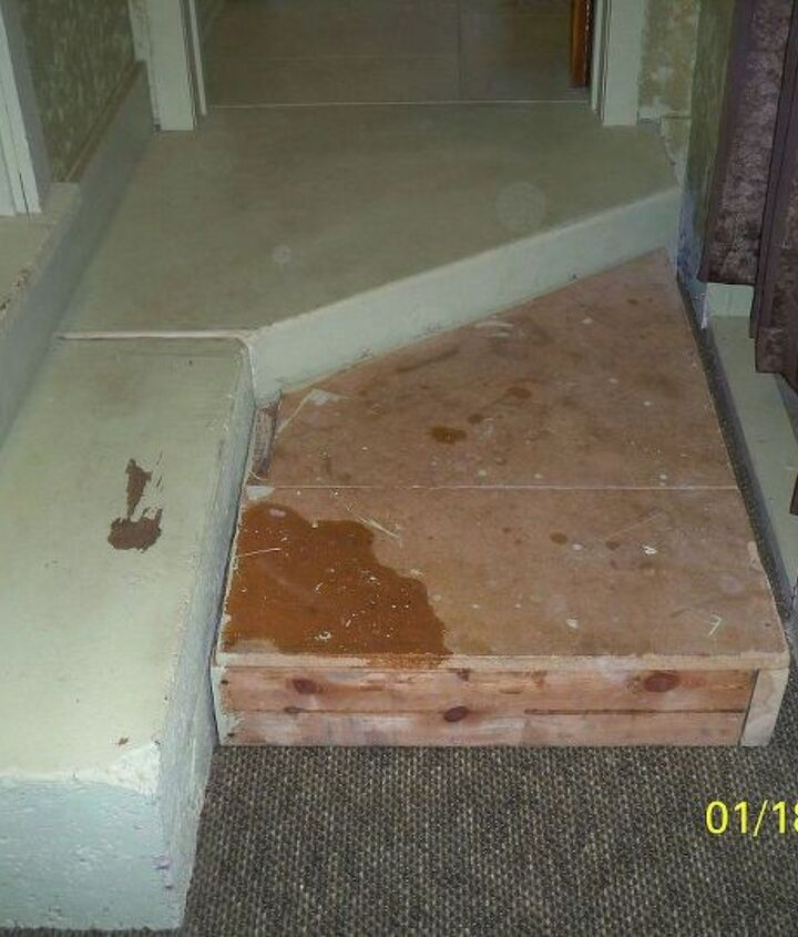 This step has a coat of paint to match the walls. Box was built for safety purposes.