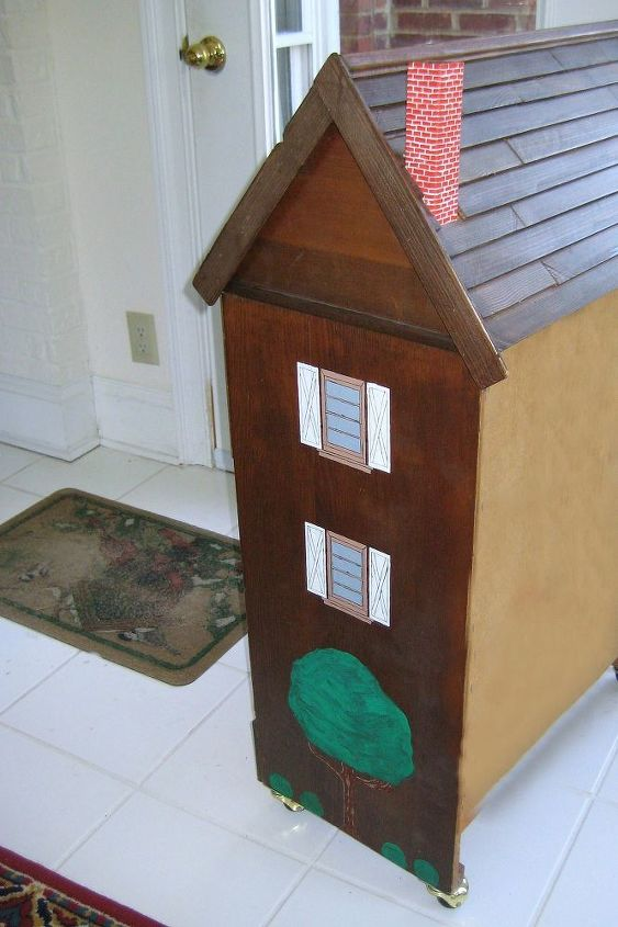 Side with windows and trees painted