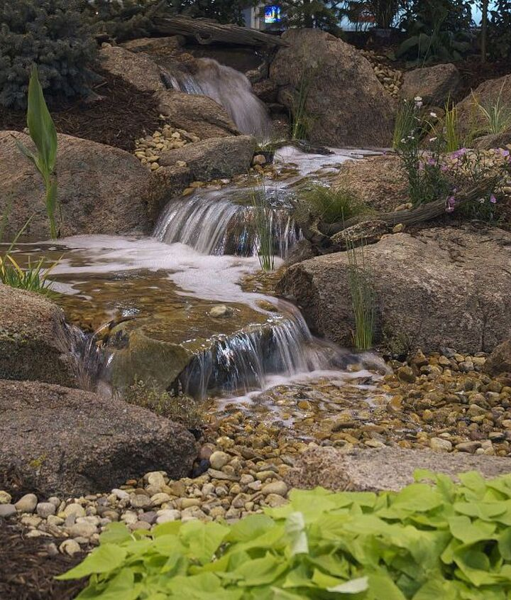 Colorado moss rock enhances this pondless water feature.