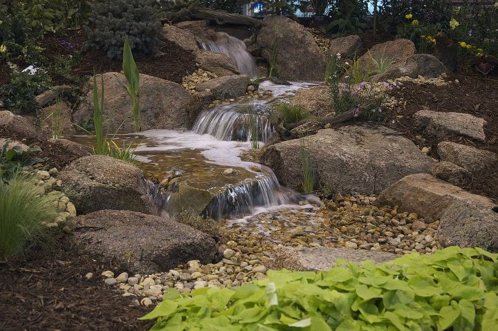 tis a privilege to live in colorado, outdoor living, ponds water features, Colorado moss rock enhances this pondless water feature
