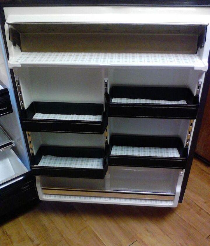 Refrigerator door shelves with vinyl liner.