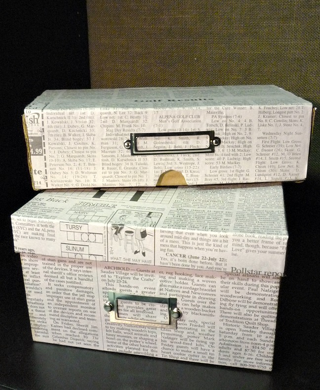 Shoe boxes covered in newspaper.