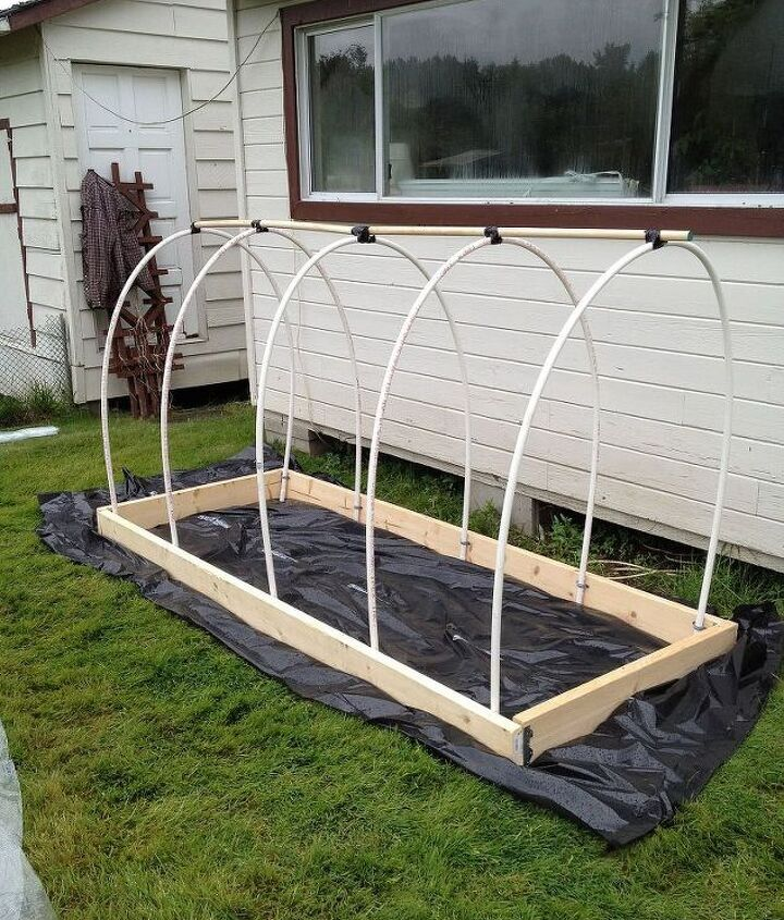 Make a frame out of 2x4's and gently bend the PVC hoops