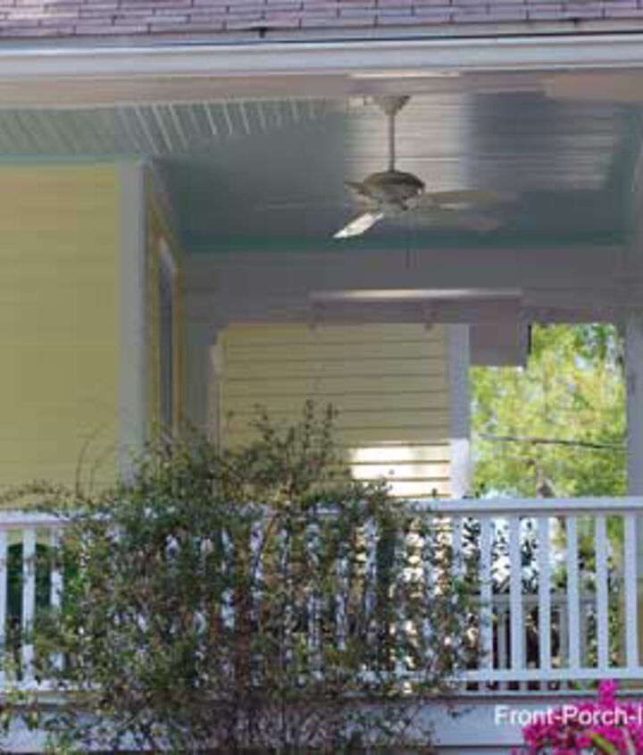 Very light blue ceiling contrasts with butter-yellow siding.