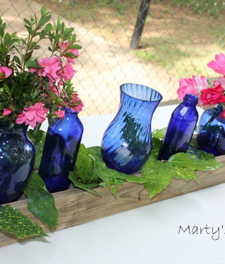 centerpiece with blue glass bottles, crafts, home decor, repurposing upcycling