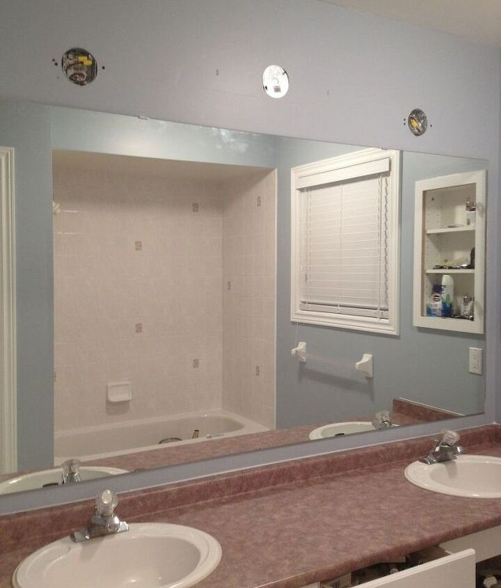 large bathroom mirror redo to double framed mirrors and cabinet, bathroom ideas, home decor, shelving ideas, Room primed and painted and the mirror was reattached