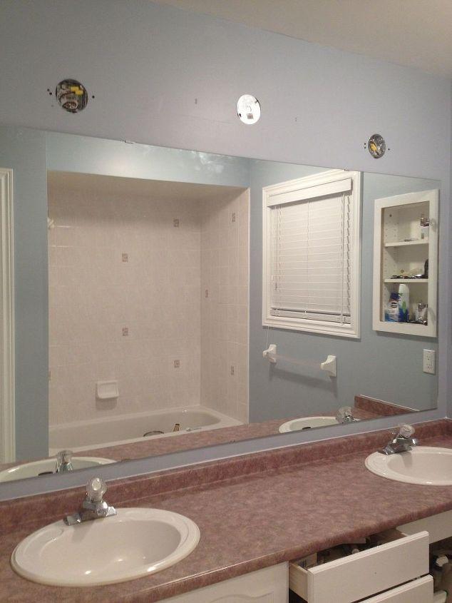 https://cdn-fastly.hometalk.com/media/2016/01/13/189845/large-bathroom-mirror-redo-to-double-framed-mirrors-and-cabinet-bathroom-ideas-home-decor-shelving-ideas.1.JPG?size=786x922&nocrop=1