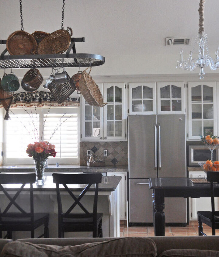 To create coziness with the high ceilings we chose to add a pot rack. This helps with limited storage too.
