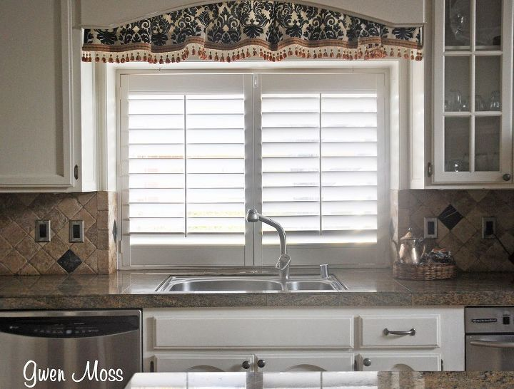 This black and cream valance is leftover from my office re-do. I just taped them from inside and voila!