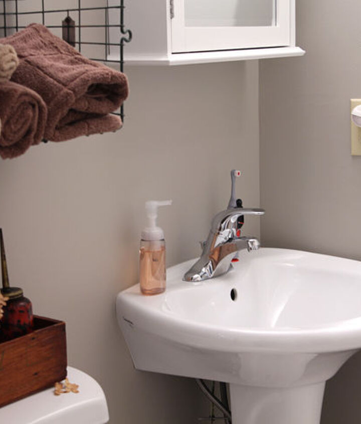 Although the pedestal sink isn't truly accessible, it works for us and opens up the room more than a roll under sink
