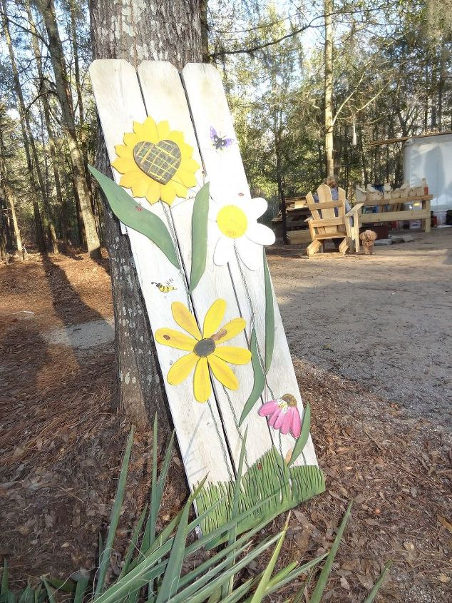 yard art i made from an old piece of fence, crafts, repurposing upcycling, Piece of old fence and some flower cutouts I made with a scroll saw