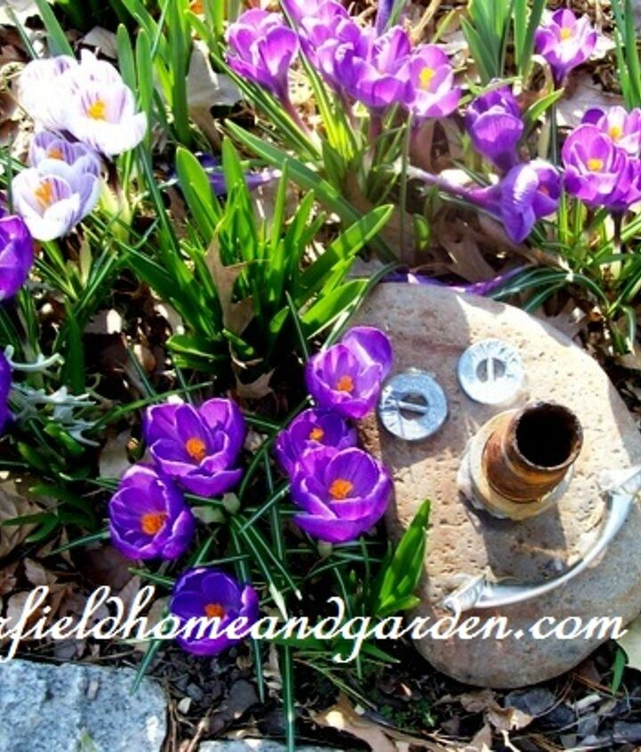 rock and junk drawer items turned into a garden accent