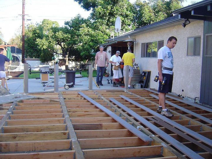 A crew of a dozen men showed up to help lay the deck.