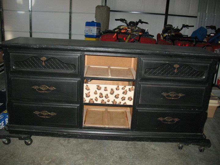 The doors from the middle were missing and the drawers were all painted with an animal print.