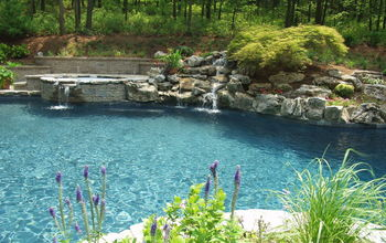 A facelift for a 22 year old? This one needed it! See how we transformed this outdated pool  to a modern natural beauty!