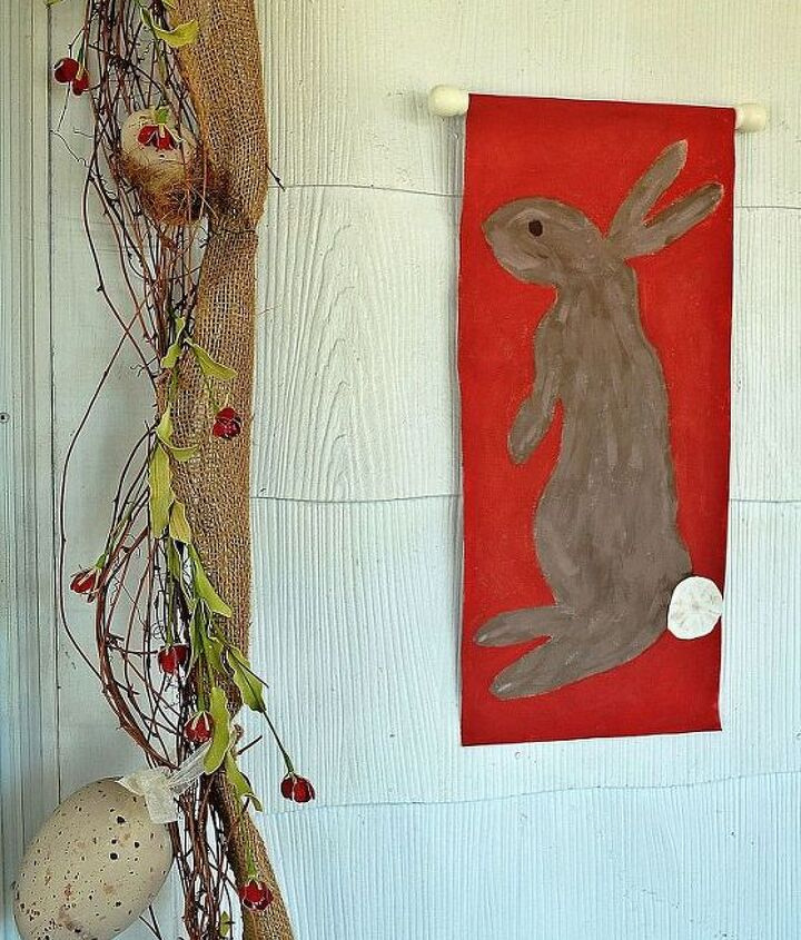 I used a grapevine and burlap garland around the front door and painted some bunnies onto an old canvas.