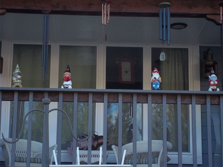 Nebraska Cornhusker gnomes, a cheerleader and a football player. They are waiting for me to plant the front garden. These are for my husband. My flying pig is in the background .