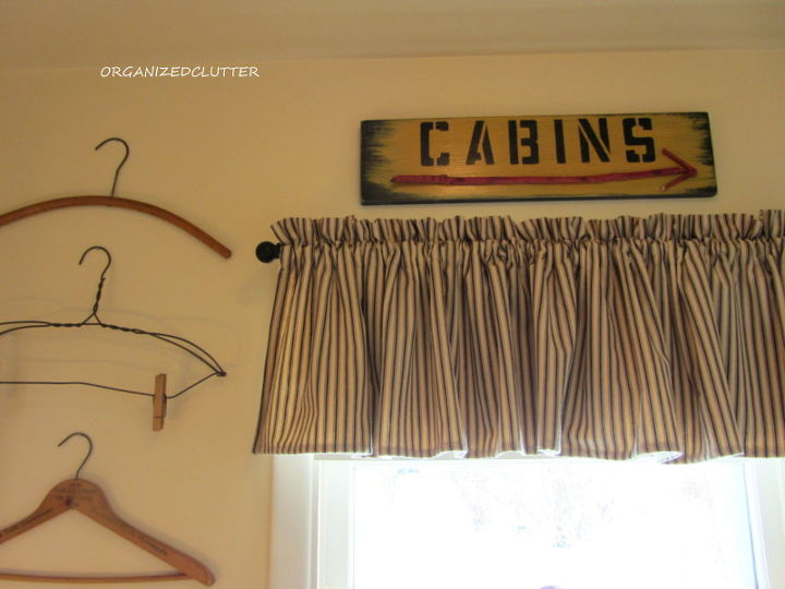 A black ticking valance and vintage signs.