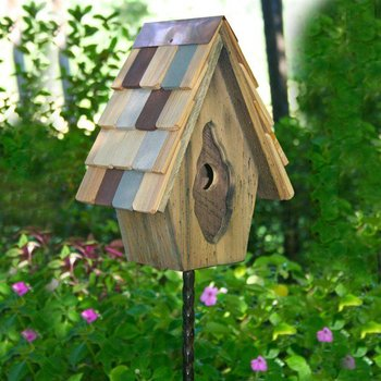 Small birdhouses can be placed on small metal or wood post or hung for depending on how you want them to appear in your garden. Yard Envy has a lot of choices on housing, posts, and information on what kind of house will work for you.