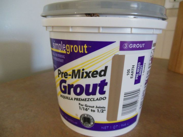 grouted vinyl tile, bathroom ideas, flooring, tile flooring, tiling, We picked up the grout at Home Depot It was about 10 for this pre mixed but I m using it for another room as well so the cost for this is actually only 5