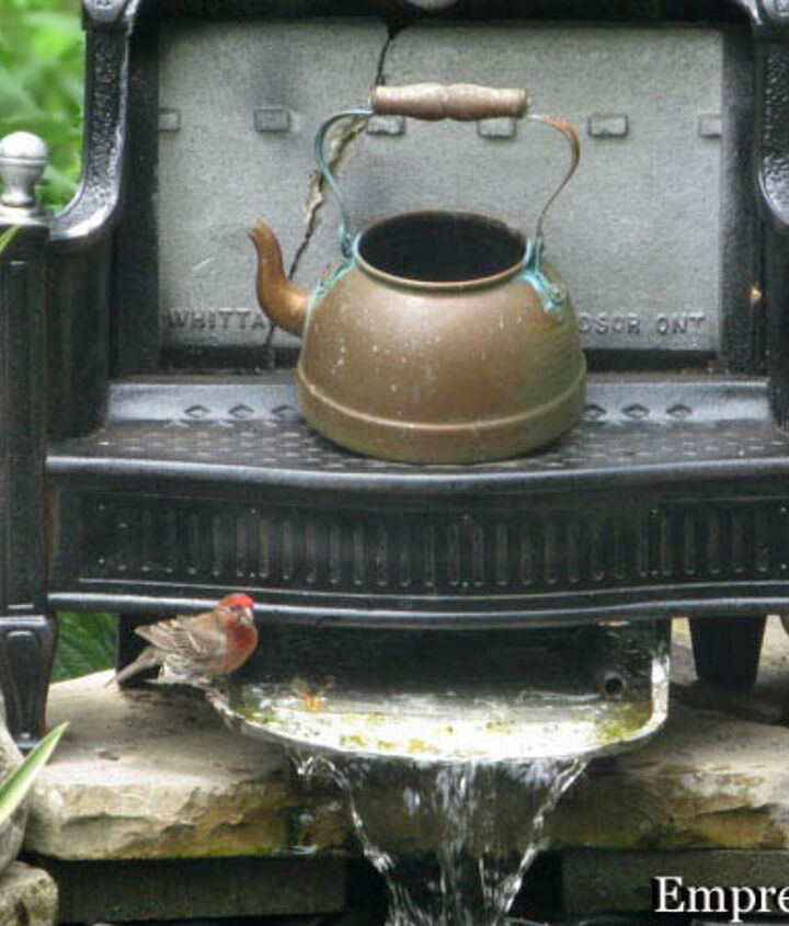 The paint roller tray forms the waterfall. I used this antique coal burner and old copper kettle to create a focal point.