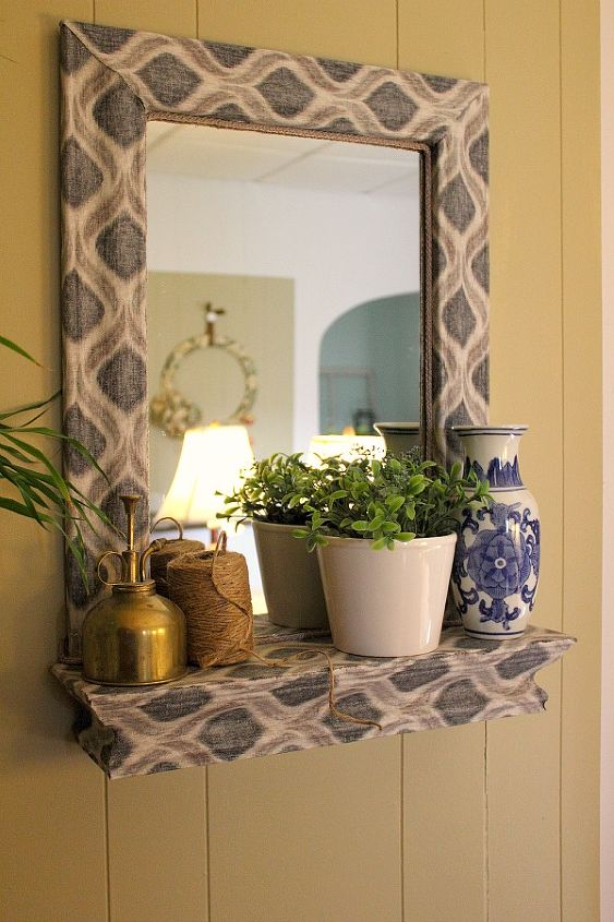 a fabric and mod podge covered mirror, crafts, decoupage, home decor, It s a little bolder than I usually go in my home but I love it So glad I took this challenge