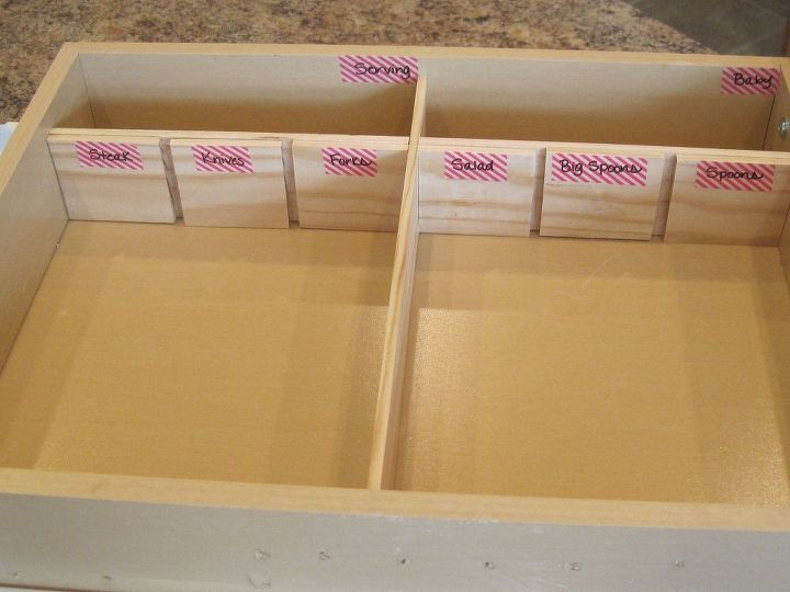 Here they are in the drawer.  This gave us the two vertical storage bins & divided the silverware storage in half.