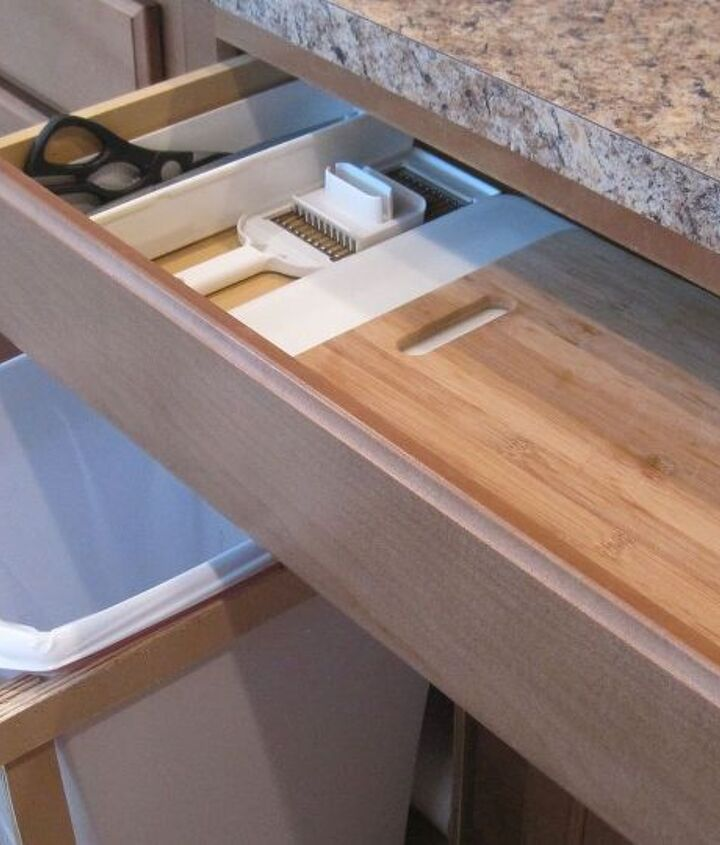 I moved my cutting boards, knives, & kitchen scissors to the drawer above the trash.  Now I have an easy prep area.