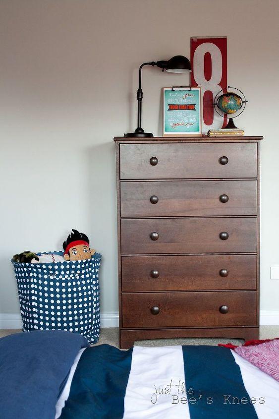 A fun polka-dot laundry hamper doubles as toy storage.