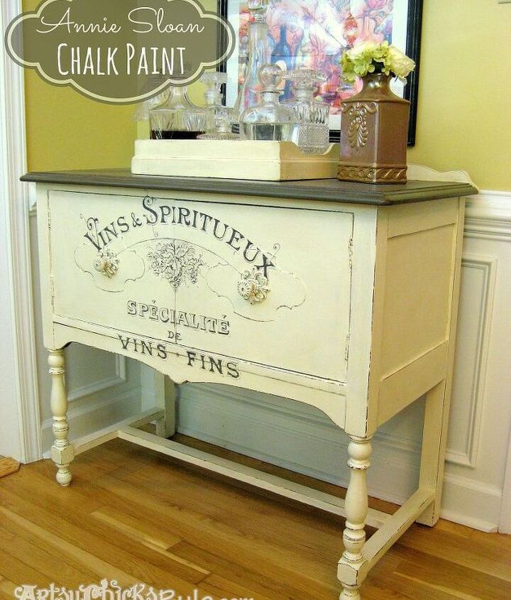 Estate sale sideboard, bought for $20, painted with chalk paint and graphics drawn on the front.