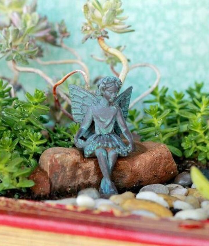 A delicate and lovely fairty sits peaceful among her garden. #AugustGarden