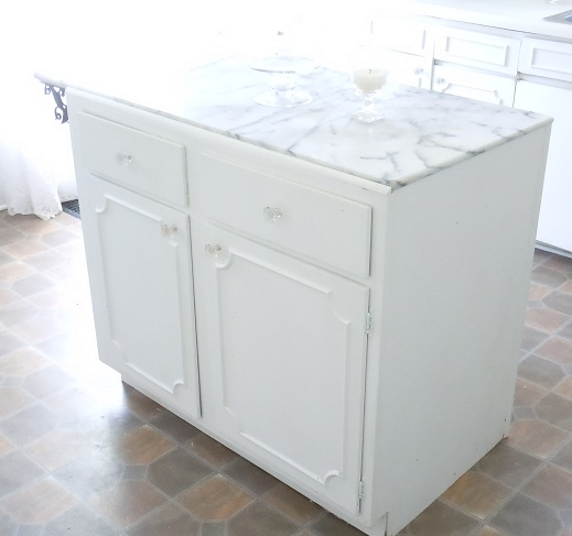 My kitchen island was a cabinet pulled out from curbside, given a fresh coat of paint, glass knobs and a marble top {Also a great score on Craigslist}.