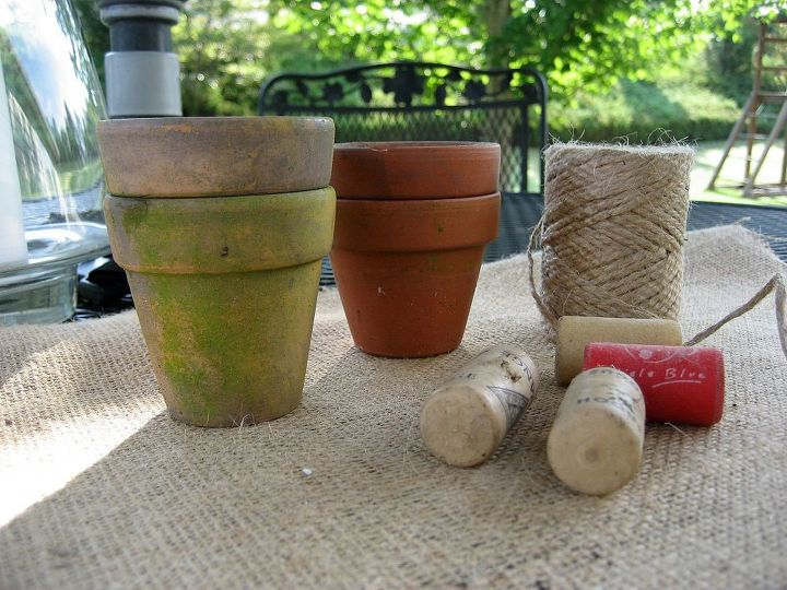a fun and whimsical flower pot man for your garden, crafts, flowers, gardening, Make the arms and legs by stacking small pots spaced with corks and threaded with twine