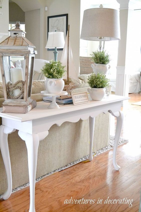 A simple Spring vignette ... on the lookout for a narrow basket or trunk for underneath the table and *then* it will be complete!