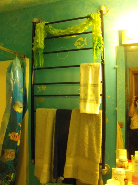 The crib springs went to make a towel rack in the kids ocean themed bathroom. Looks like the ladder on a boat, don't you think?