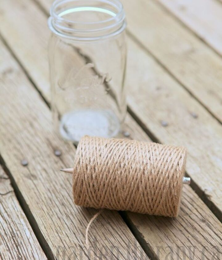 Wind twine around a pencil or poke a pencil through a roll of twine