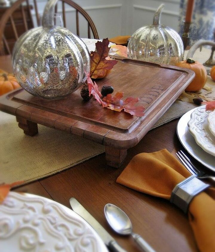 A vintage-look monogram, some stain and legs transform an old cutting board to an elegant serving board or trivet.